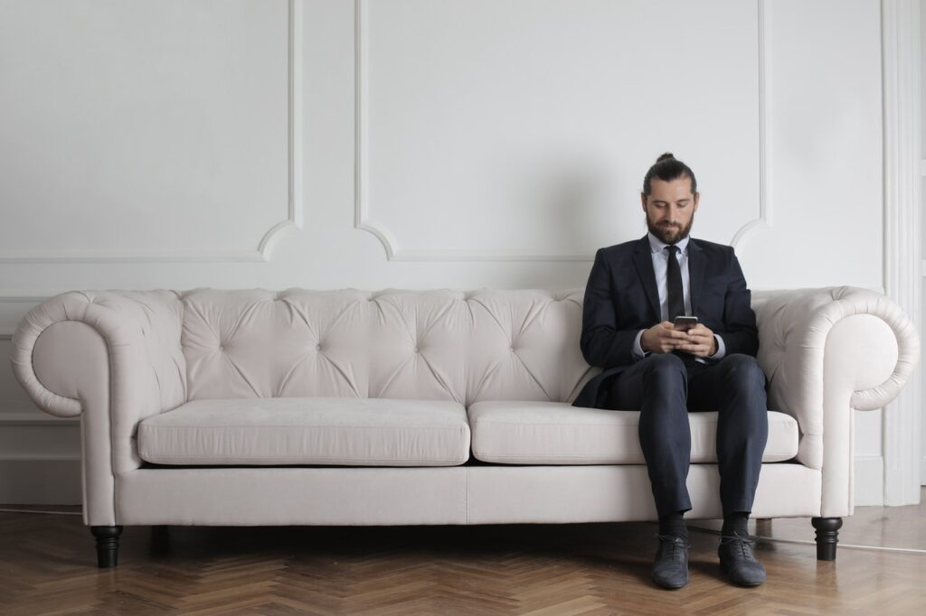 Man wearing a suit in the waiting room before the interview